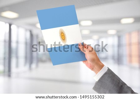 Man Holding Flag of Argentina. Argentina in Hand. #1495155302