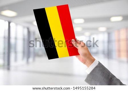 Man Holding Flag of Belgium. Belgium in Hand. #1495155284