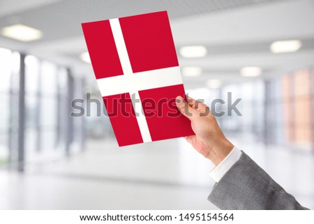 Man Holding Flag of Denmark. Denmark in Hand. #1495154564