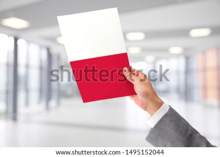 Man Holding Flag of Poland. Poland in Hand. #1495152044