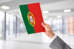 Man Holding Flag of Portugal. Portugal in Hand.