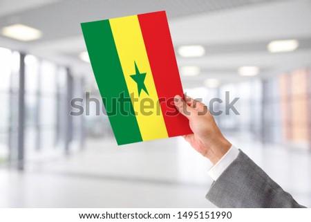 Man Holding Flag of Senegal. Senegal in Hand. #1495151990