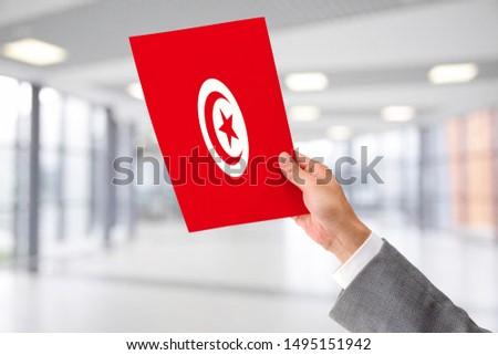 Man Holding Flag of Tunisia. Tunisia in Hand. #1495151942