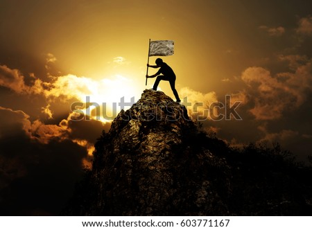 Man holding flag on the peak of mountain and sunset outdoor on nature , success winner business concept