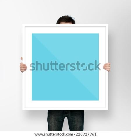 man holding frame on white background #228927961