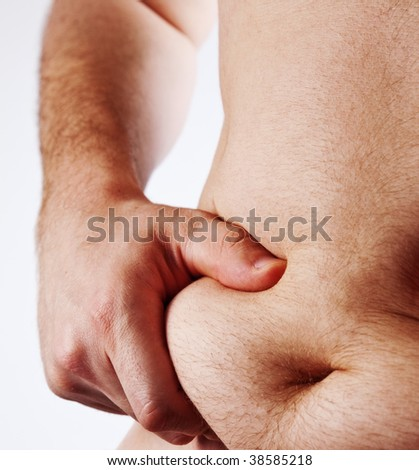 Man holding his fat belly isolated on white background - stock photo