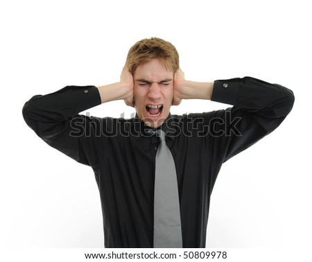 Man holding his hands up to his ears trying to mute all the voices he hears