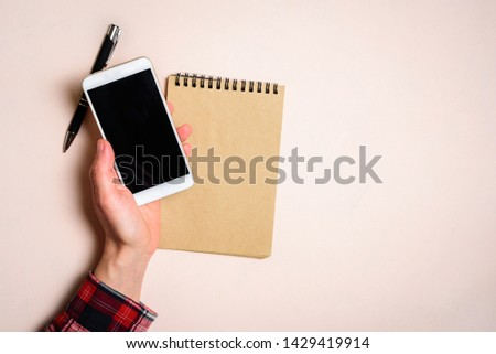 Man holding his phone by left hand. Left hander day concept. Working place of lefty #1429419914