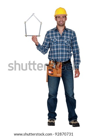Man holding house-shaped measuring device
