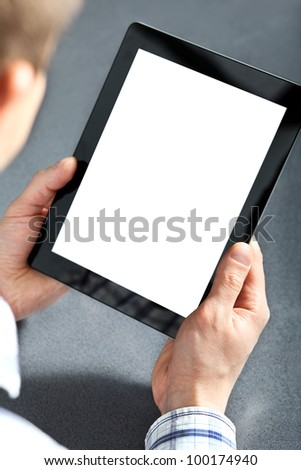 man holding in hands a touch pad tablet gadget.