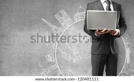 man holding laptop traveling concept