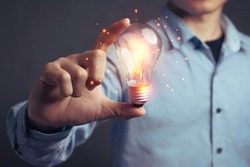 Man holding light bulbs, ideas of new ideas beautiful creative and communicate the new inventions with innovative technology and creativity. concept creativity with bulbs that shine glitter