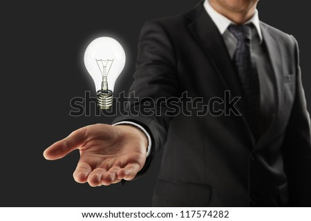 man holding lightbulb in hand