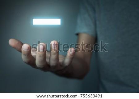 Man holding minus sign.
