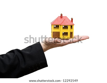 man holding model house in a hand - stock photo