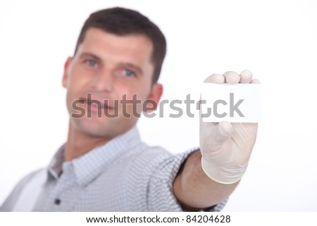 man holding out blank business card