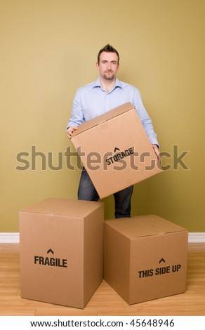 Man holding packed box, getting ready to move