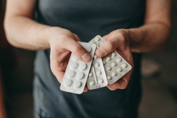man holding pills at home in Blister. pills packed with disease