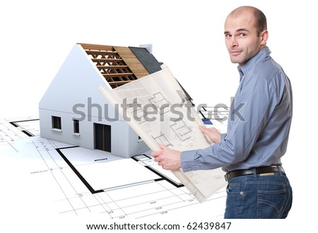 Man holding plans and house in construction at the background - stock photo
