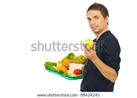 Man holding plateau with healthy food and choose green apple to eat isolated on white background
