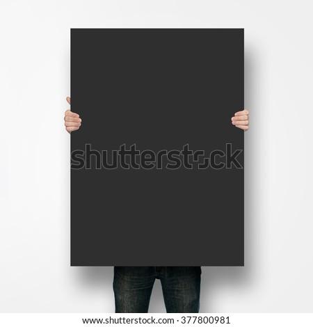 Man holding poster mockup #377800981