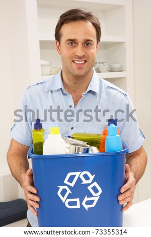 Man Holding Recyling Waste Bin At Home