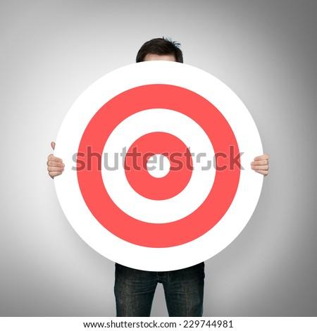 man holding red darts target #229744981