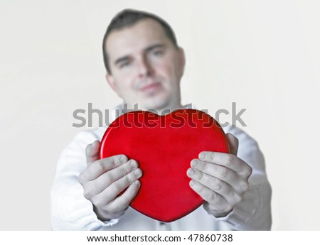 Man holding red heart
