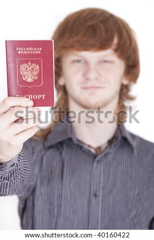 man holding russian passport in a camera