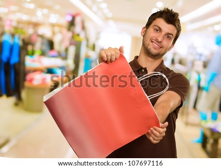 Man Holding Shopping Bag, Indoor
