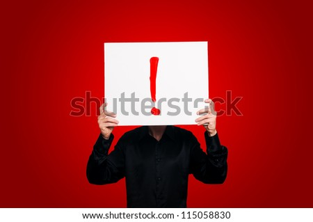 man holding sign exclamation mark on red backgound