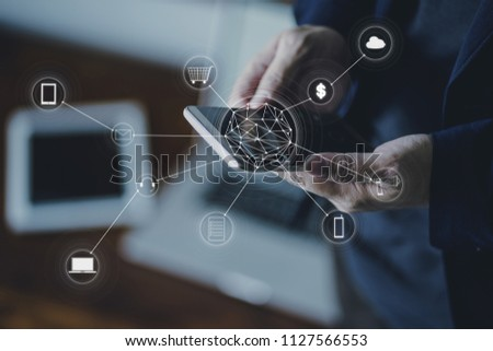 Man holding smart phone making online shopping and banking payment.