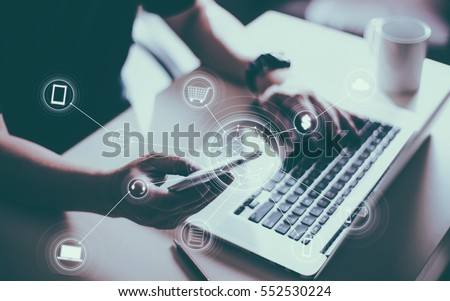 Man holding smart phone making online shopping and banking payment. Blurred background . #552530224