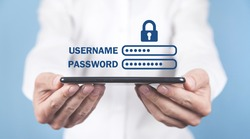Man holding smartphone. Username and Password with padlock