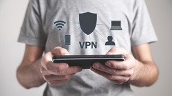 Man holding smartphone. VPN concept