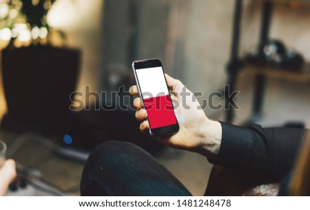 Man holding Smartphone with Flag of Poland. Poland Flag on Mobile Screen. #1481248478