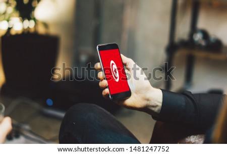 Man holding Smartphone with Flag of Tunisia. Tunisia Flag on Mobile Screen. #1481247752