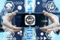Man holding smartphone with sap micro chip icon on screen. SAP - Business process automation software. ERP enterprise resources planning system concept.