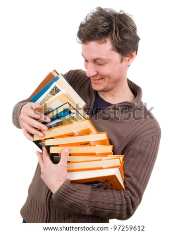 man holding stack of books