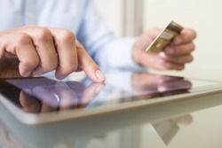 Man holding tablet pc and credit card indoor, Shopping Online