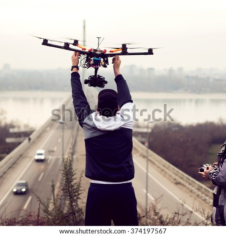 Man holding the drone, preparing for take off.