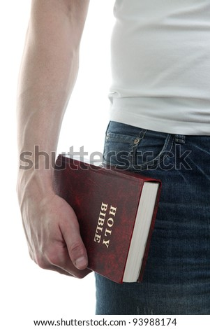 Man holding the Holy Bible, isolated on white background
