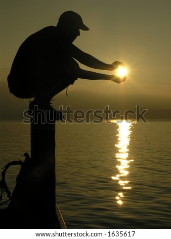 Man holding the sun