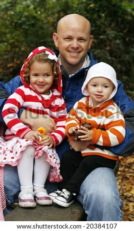 man holding two children on lap