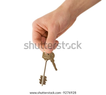 Man holding two keys in his hand on white background