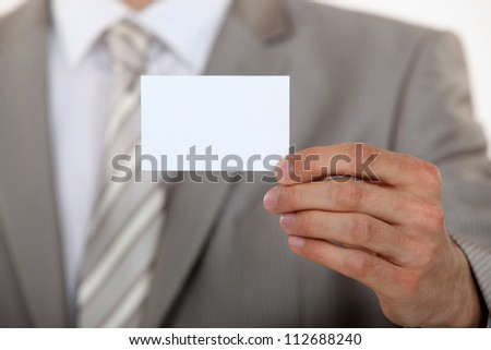 Man holding up a blank business card