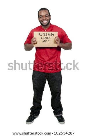 Man holding up a sign that says Somebody Loves Me