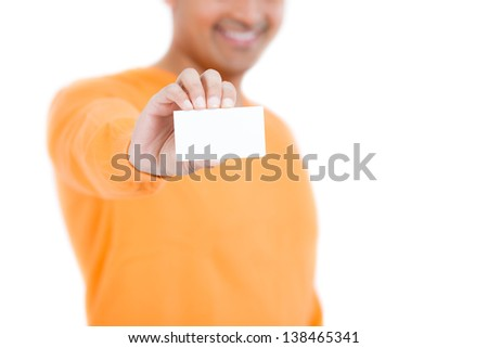 Man holding up blank business card