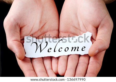 Man holding welcome word in palm