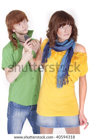 man holding woman by a hand and looking at mobile phone